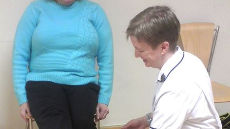 Becky Chapman, physiotherapist at West Suffolk NHS Foundation Trust, offers patients therapy as part