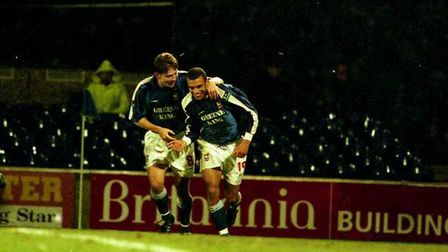 Neil Midgley celebrates his debut goal with Matt Holland as Town beat West Brom 3-0 at Portman Road
