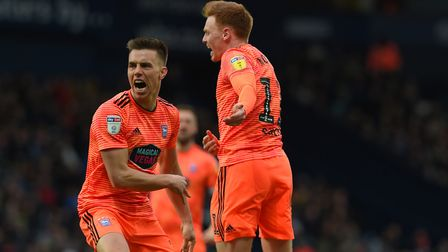 Jon Nolan celebrates his headed equaliser at West Brom with Jonas Knudsen during the second half Pic