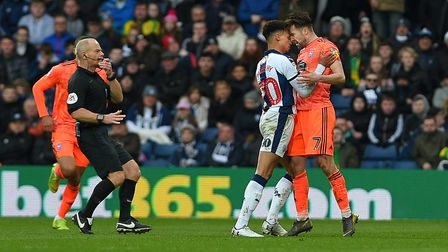 Gwion Edwards fronts up to West Brom's Jacob Murphy after a cynical foul Picture Pagepix