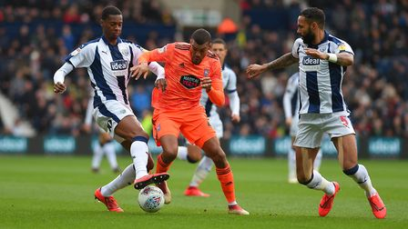 Collin Quaner tries to battle through the WBA defence Picture Pagepix