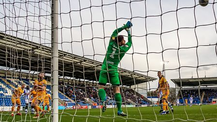 Frank Nouble watches as his spectacular shot loops over the top of Newport County keeper Joe Day for