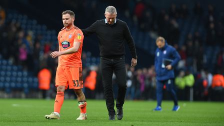 Alan Judge gets a pat on the back from Paul Lambert after the final whistle at West Brom Picture Pag