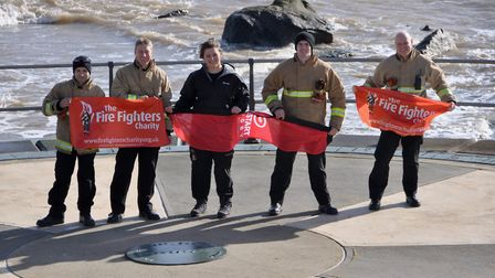 Firefighter Sasha Acheson (centre) is supported by local firefighters as she sets off on her 500-mil