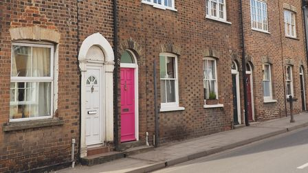 Terraced houses on Cross Street were originally have been constructed for Weavers working in the tow