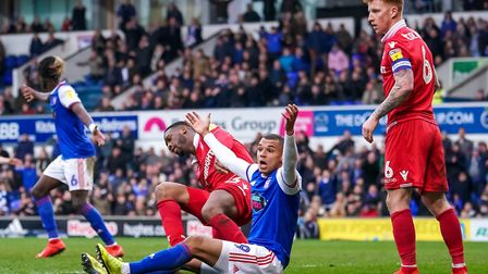 Kayden Jackson appeals after being held back by Jack Colback and clattered into by Molla Wague, whil
