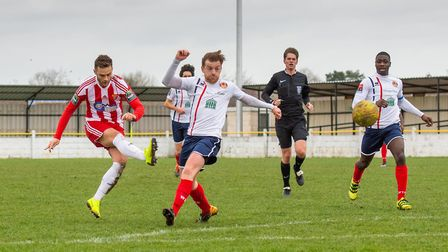 Callum Bennett (red and white) equalises for the Seasiders with a superb strike in the 33rd minute.