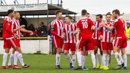 Seasiders' Callum Bennett (second from right) is congratulated by teammates following his first half