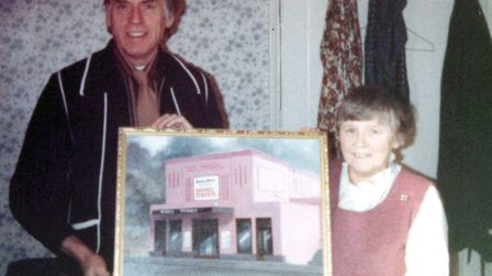 A flashback picture of Joyce Dowding and Larry Grayson holding a photograph of the Regent Cinema in