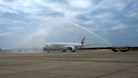 The first Emirates aircraft arriving at London Stansted Airport under a celebratory water arch in Ju