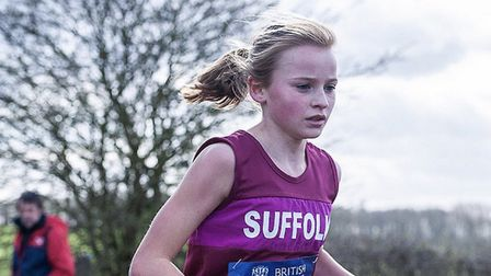 Ruby Vinton out on her own as she wins the under-13 girls' title at the Inter-Counties Cross Country