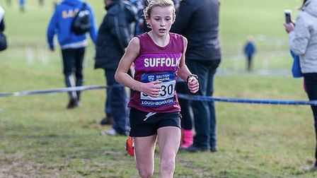 Ruby Vinton, in Suffolk colours, on her way to victory in the under-13 girls' race at Loughborough o