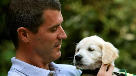 Keane, pictuted holding puppy Verna to launch the Irish Guide Dogs for the Blind Super Value Shades