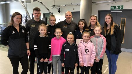 Nino Severino with some of his Team Hub members, plus Pipers Vale gymnasts and coaches. Picture: NIN