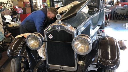Engineer Rob Godwin working on a Buick in the Rickinghall workshop Picture: BELCHER ENGINEERING