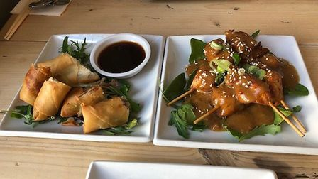 The shared starters at Mings Oriental - satay chicken (right) and crispy duck rolls. Picture: MARK H