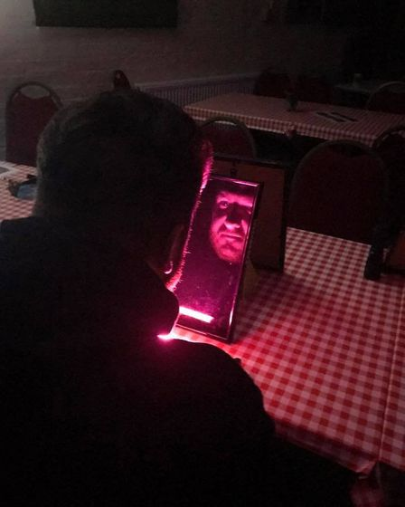 The mirror scrying technique being used at Rougham airfield Picture: GHOST HUNT UK