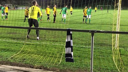 Lakenheath keeper Frank Gammon prepares to deal with a Fakenham free-kick in the first half. Picture