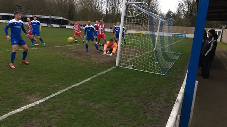Bury keeper Luis Tibbles makes a fine save down at his near post to prevent Bowers & Pitsea from sco