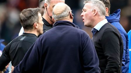 Town manager Paul Lambert has words with referee Keith Stroud after the game. Picture: STEVE WALL