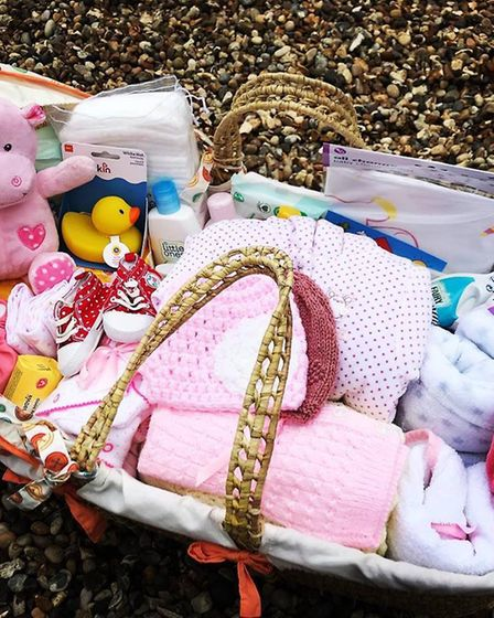 One of the Moses Project's baskets full of items for a newborn. Picture: THE MOSES PROJECT