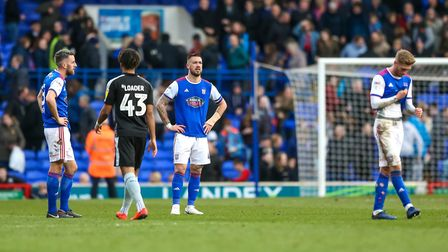 Town players Cole Skuse, Luke Chambers and Teddy Bishop pictured at the final whistle in the defeat