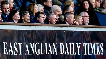 Town manager Paul Lambert sits in the directors box next to general manager of football operations L