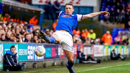 Matthew Pennington at full stretch as he tries to keep the ball in. Picture: Steve Waller www.