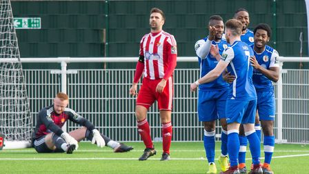 GRAYS JOY: Frustration for Felixstowe as Aron Gordon (blue, right) puts Grays back in the lead.Phot