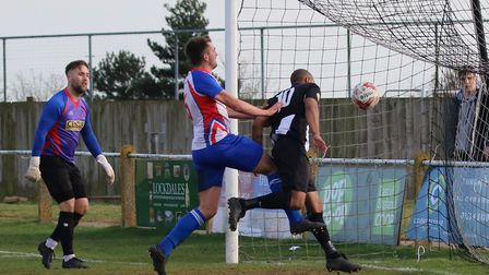 Kelsey Trotter scores his second for the Peckers against FC Clacton Photo; PAUL LEECH