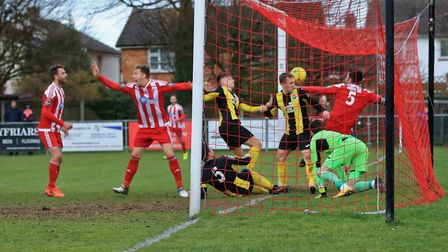 GOAL: Josh Kerridge's, (second left), last minute shot goes over the line to secure all three point