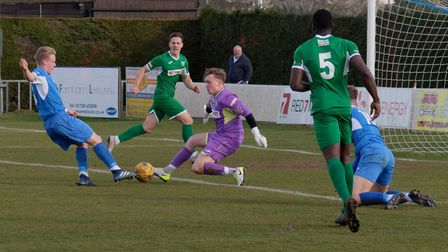 Bedworth 'keeper Adam Harrison prevents Harrison Bacon from getting in a shot Photo: PAUL VOLLER