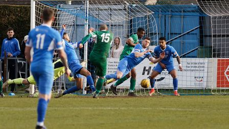 GOAL! Iyseden Christie (No 15) fires Bedworth into the lead against Leiston Photo: PAUL VOLLER