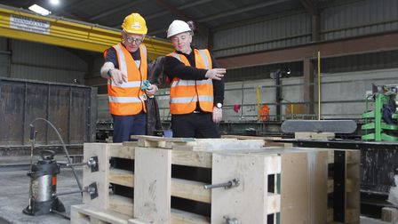 From left, Norman Lloyd and Tim Evans on the Elmer plinths made by Poundfield