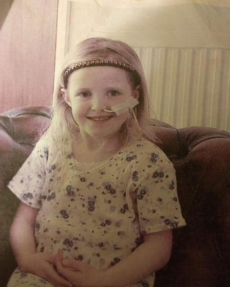 Jess Shire with her feeding tube as a youngster Picture: JESS SHIRE