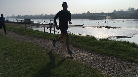 A runner in silhouette during last Saturday's sunlit South Woodham Ferrers parkrun. Picture: CARL MA