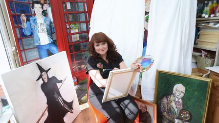 Artist Michelle Deyna-Hayward in her studio in Eye with some of her work, including on her portrait