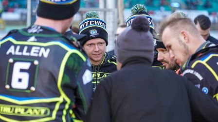 Cameron Keeps listens intently to Witches team manager Ritchie Hawkins during a team talk ahead of t
