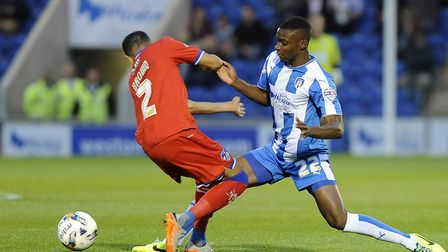 Kane Vincent-Young, right. in action during Oldham's last visit to the Community Stadium, in August,