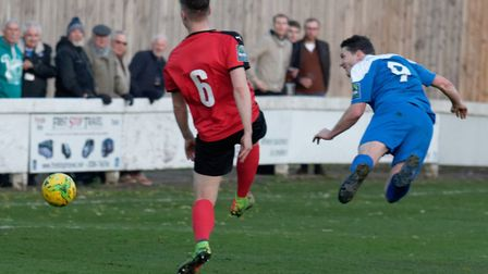 Bury Town's Ollie Hughes, right, heading home a spectacular goal during the 3-2 defeat to Coggeshall
