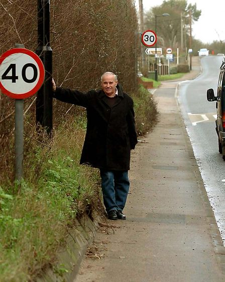 Richard Kemp pictured with the sign at Rodbridge, Long Melford in 2008 which was not working Picture