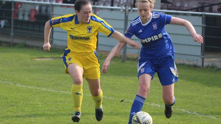 Town full back Nicole Pannifer battles for the ball in the second half Picture: ROSS HALLS