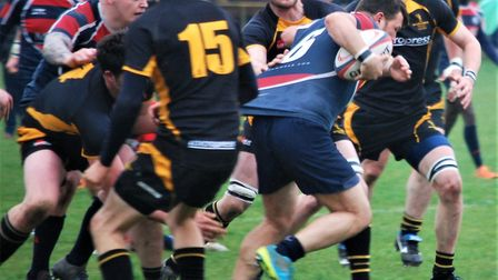 Stowmarket man of the match Bob Burch rumbles forward in their win over Southwold. Picture: SALLY LI