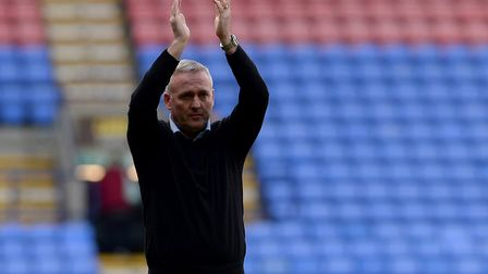 Ipswich manager Paul Lambert applauds the fans as his team gain a rare away win at Bolton Picture Pa