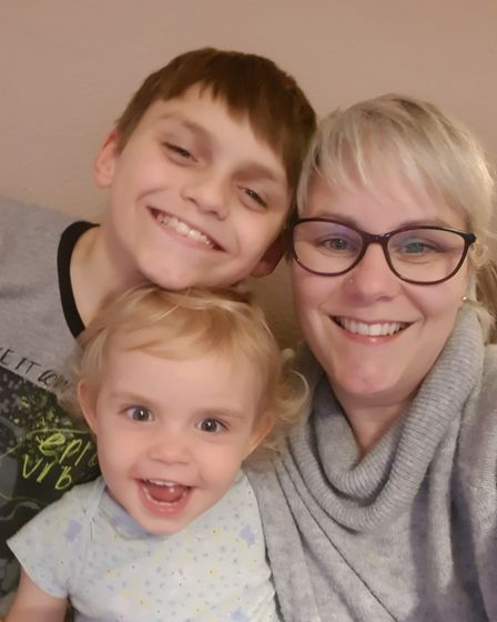 Mum of five Sam Dale, with son Adam, 11, and daughter Emily, two Picture: SAM DALE