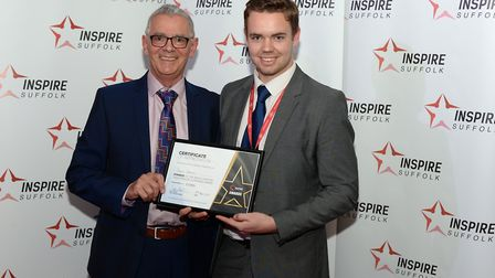 Jacob Charles, winner of Excellence in Teaching with Chair of Inspire Suffolk, Dave Muller Picture