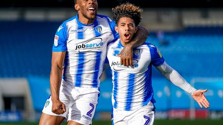 Ryan Jackson, right. celebrates with Courtney Senior after the latter's goal against Newport in a 3-