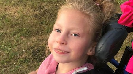Teigan Bayliss, aged 7, her smile has inspired a festival called TeigyFest which will take place in