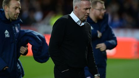 Paul Lambert leaves the field following Wednesday night's 2-0 defeat at Brentford. Photo: Pagepix