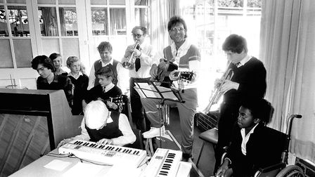 Ipswich pupils having a music lesson with Sir Cliff Richard Picture: RICHARD SNASDELL